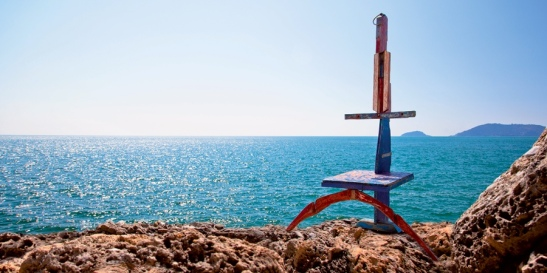 Mediterranean Sea. One of a series of sculptures by Luigi Camarilla, made out of the wood of abandoned fishing and migrant boats in Sicily.