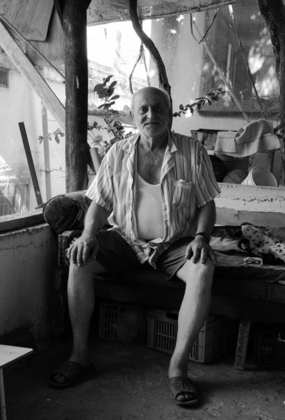 Portrait of a Palestinian fisherman. He was very happy to pose for photos. He was convalescing from an injury to his leg which kept him housebound for a while. He was very eager to return to his little boat as soon as he recovered.