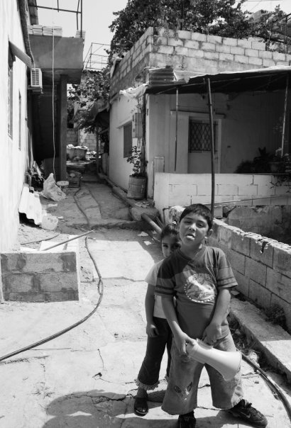 A very mischievous pair who followed me for a short while, shouting through their megaphone. His name was Charbel. He stuck his tongue out at me when I tried to photograph him and his shy sister.